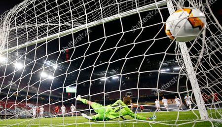 Copenhagen's goalkeeper Karl-Johan Johnsson fails to make save on a penalty shot by Manchester United's Bruno Fernandes during the UEFA Europa League quarterfinal soccer match between Manchester United and FC Copenhagen in Cologne, Germany