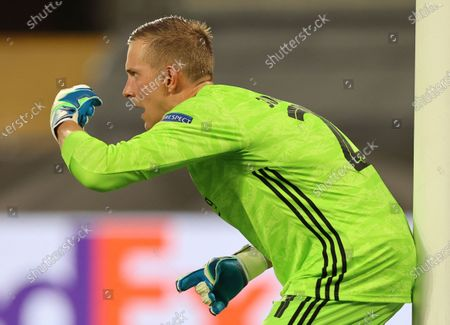 Copenhagen's goalkeeper Karl-Johan Johnsson gestures during the UEFA Europa League quarterfinal soccer match between Manchester United and FC Copenhagen in Cologne, Germany