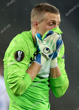 Copenhagen's goalkeeper Karl-Johan Johnsson wipes his face during the UEFA Europa League quarterfinal soccer match between Manchester United and FC Copenhagen in Cologne, Germany