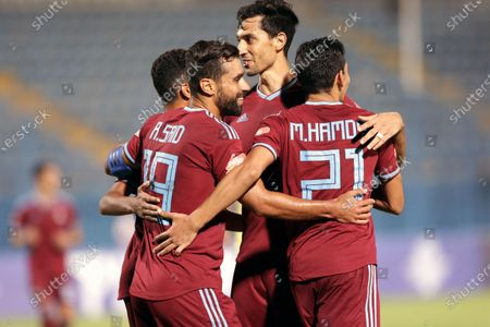 Pyramids FC player Abdallah El-Said (L) celebrates with teammates after scoring a goal during the Egyptian league soccer match between  Pyramids FC and Tanta at 30 June Stadium in Cairo, Egypt, 10 August 2020.