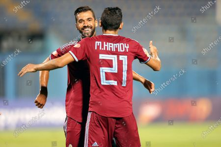 Pyramids FC player Abdallah El-Said (L) celebrates with teammate Mohamed Hamdi (R) after scoring a goal during the Egyptian league soccer match between  Pyramids FC and Tanta at 30 June Stadium in Cairo, Egypt, 10 August 2020.