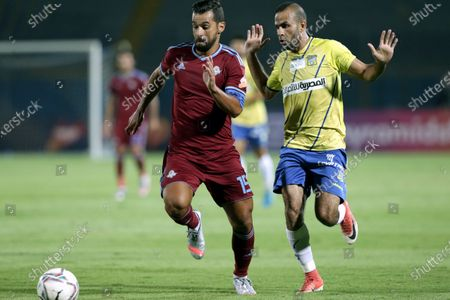 Pyramids FC player Abdallah El-Said (L) in action against Tanta player Ahmed Fahmy  (R) during the Egyptian league soccer match between  Pyramids FC and Tanta at 30 June Stadium in Cairo, Egypt, 10 August 2020.