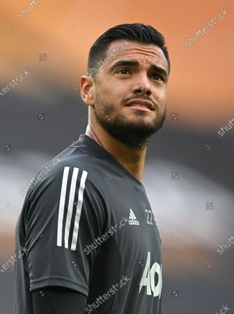 Manchester United's goalkeeper Sergio Romero warms up ahead of the UEFA Europa League quarter final soccer match between Manchester United and FC Copenhagen in Cologne, Germany, 10 August 2020.