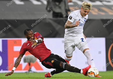 Manchester United's Fred (L) in action against Copenhagen's Guillermo Varela (R)  during the UEFA Europa League quarter final soccer match between Manchester United and FC Copenhagen in Cologne, Germany, 10 August 2020
