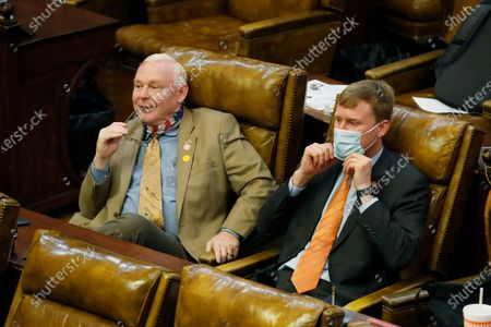 Stock Image of An unmasked Republican Rep. Dana Criswell of Olive Branch, left, sits alongside masked Republican colleague Joel Bomgar, of Madison, as they listen to House Education Committee chairman Richard Beckett, unseen, explain the partial veto of the education budget bill in July by Gov. Tate Reeves, at the Capitol in Jackson, Miss. The House voted 109-7 to override Reeves's veto of the education bill