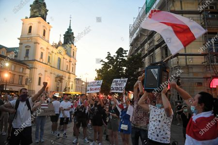 Participants of the demonstration of support organized under the slogan 'Minsk-Warsaw, common cause!' in Warsaw, Poland 10 August, 2020. On the night of August 9-10, clashes with the police took place in many cities in Belarus. Protests broke out after the announcement of preliminary results, according to which the current president Alyaksandr Lukashenka won.