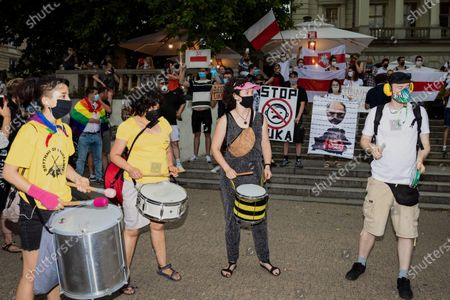 LGBT activists and supporters take part in a demonstration in Poznan, Poland, 10 August 2020. The protest was organized under the slogan 'Poznan defends the rainbow' after Friday events related to the arrest of the LGBT activist Michal Sz. also known as Malgorzata Sz. or 'Margot'. LGBT activists were joined by the participants of the demonstrations under the slogan 'Freedom for Belarus'. Both demonstrations met and joined together at Freedom Square in Poznan.