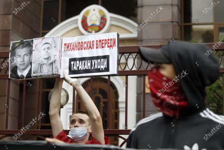 """A man wearing a mask holds a placard reading """"Tikhanovskaya is a head, a cockroach ( demanding Belarus President Alexander Lukashenko to leave power!) during the rally. Belarusian citizens living in Ukraine held a rally of solidarity with Belarus opposition outside the Embassy of Belarus, protesting vote rigging in the presidential election held in Belarus on the 9th Aug 2020, demanding the presidential election results not to be recognized."""