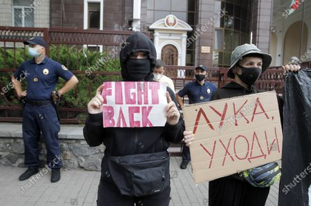 An activist wearing a mask (R) holds a placard reading Luka, commanding the Belarus President Alexander Lukashenko to go away!, during a rally. Belarusian citizens living in Ukraine held a rally of solidarity with Belarus opposition outside the Embassy of Belarus, protesting vote rigging in the presidential election held in Belarus on the 9th Aug 2020, demanding the presidential election results not to be recognized.