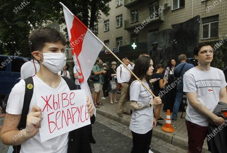 Belarusian youth living in Ukraine hold placards and historic Belarusian flags in support of the Belarus opposition during a rally. Belarusian citizens living in Ukraine held a rally of solidarity with Belarus opposition outside the Embassy of Belarus, protesting vote rigging in the presidential election held in Belarus on the 9th Aug 2020, demanding the presidential election results not to be recognized.