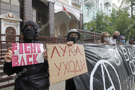 Belarusian citizens wearing masks in Ukraine hold placards in support of the Belarus opposition during a rally. Belarusian citizens living in Ukraine held a rally of solidarity with Belarus opposition outside the Embassy of Belarus, protesting vote rigging in the presidential election held in Belarus on the 9th Aug 2020, demanding the presidential election results not to be recognized.