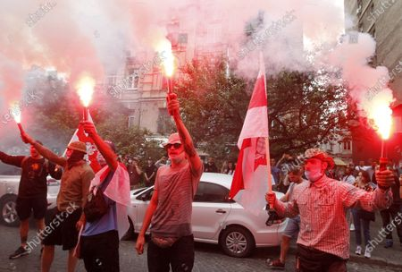 Belarusian citizens in Ukraine burn flares and hold flags during a rally. Belarusian citizens living in Ukraine held a rally of solidarity with Belarus opposition outside the Embassy of Belarus, protesting vote rigging in the presidential election held in Belarus on the 9th Aug 2020, demanding the presidential election results not to be recognized.