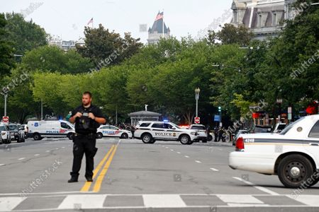 Law enforcement officials gather following a shooting that took place at 17th Street and Pennsylvania Avenue near the White House, in Washington
