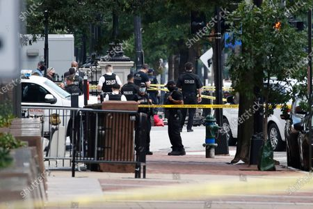 Law enforcement officials gather following a shooting at 17th Street and Pennsylvania Avenue near the White House, in Washington