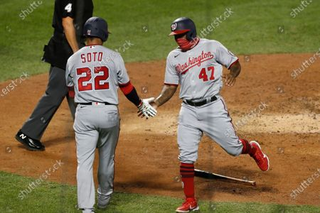 Washington Nationals' Juan Soto (22) celebrates with designated hitter Howie Kendrick (47) after the pair scored on Asdrubal Cabrera's fifth-inning double in a baseball game against the New York Mets, in New York