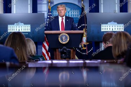 United States President Donald J. Trump speaks during a news conference in the James S. Brady Press Briefing Room at the White House in Washington D.C., U.S.. Trump was abruptly ushered out of the briefing room by Secret Service after shots were reportedly fired in the area.