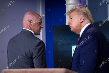 United States President Donald J. Trump is escorted out of a news conference in the James S. Brady Press Briefing Room at the White House in Washington D.C., U.S.. Trump was abruptly ushered out of the briefing room by Secret Service after shots were reportedly fired in the area.