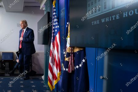 United States President Donald J. Trump arrives to a news conference in the James S. Brady Press Briefing Room at the White House in Washington D.C., U.S.. Trump was abruptly ushered out of the briefing room by Secret Service after shots were reportedly fired in the area.