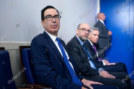 United States Secretary of the Treasury Steven T. Mnuchin listens during a news conference in the James S. Brady Press Briefing Room at the White House in Washington D.C., U.S.. Trump was abruptly ushered out of the briefing room by Secret Service after shots were reportedly fired in the area.