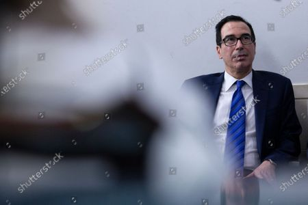United States Secretary of the Treasury Steven T. Mnuchin listens as United States President Donald J. Trump speaks during a news conference in the James S. Brady Press Briefing Room at the White House in Washington D.C., U.S.. Trump was abruptly ushered out of the briefing room by Secret Service after shots were reportedly fired in the area.