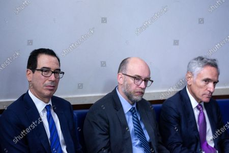 From left to right: United States Secretary of the Treasury Steven T. Mnuchin, Director, Office of Management and Budget (OMB) Russell Vought, and Senior Fellow in Scientific Philosophy and Public Policy at Stanford University's Hoover Institution, and Stanford University Professor Scott Atlas listen as United States President Donald J. Trump speaks during a news conference in the James S. Brady Press Briefing Room at the White House in Washington D.C., U.S.. Trump was abruptly ushered out of the briefing room by Secret Service after shots were reportedly fired in the area.