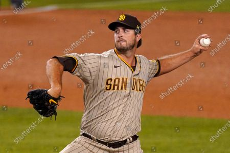 San Diego Padres relief pitcher Drew Pomeranz throws to the plate during the ninth inning of a baseball game against the Los Angeles Dodgers, in Los Angeles