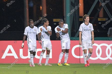 Philadelphia Union midfielder Jose Andres Martinez, second from left, and forward Sergio Santos, second from right, celebrate with a dance after Santos scored a goal during the first half of an MLS soccer match against Sporting Kansas City, in Kissimmee, Fla