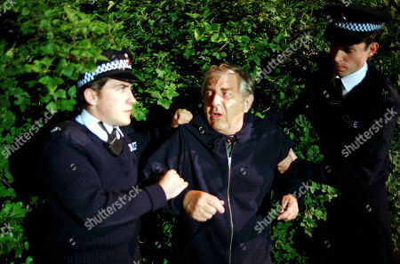 Stock Image of Coronation Street - Ep 3893 Wednesday 9th August 1995  Derek finds himself on the wrong side of the law when he tries to solve the mystery of Arthur the missing gnome. L-R: PC, as played by Jason Done, Derek Wilton, as played by Peter Baldwin, and other PC played by Mark Charnock.