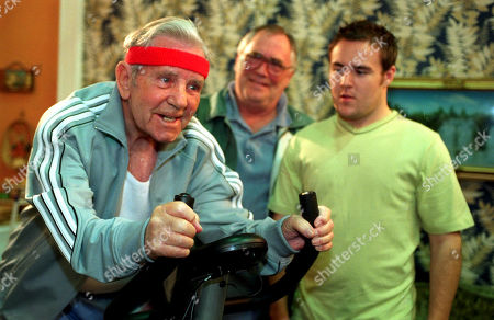 Coronation Street - Ep 5792 Friday 2nd July 2004  Ernie Crab, as played by Norman Wisdom, shows up at the Duckworths to buy Jack Duckworth's, as played by William Tarmey, exercise bike. Also pictured Tyrone Dobbs, as played by Alan Halsall.