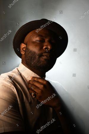 Blitz Bazawule Director