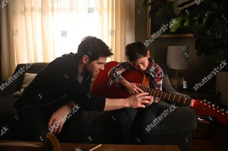 Stock Photo of David Giuntoli as Eddie Saville and Tristan Byon as Theo Saville