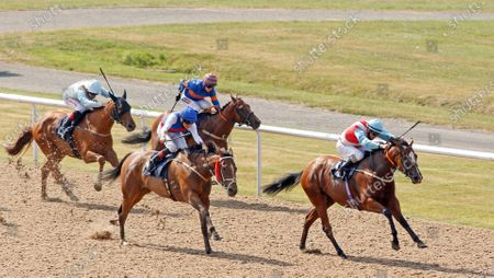 Stock Picture of MAID MILLIE (centre, Tim Clark) beats ELZAAM'S DREAM (right) in The Sky Sports Racing Sky 415 Handicap Wolverhampton