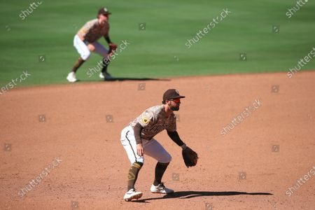 San Diego Padres' Greg Garcia gets into a defensive position against the Arizona Diamondbacks in the ninth inning of a baseball game, in San Diego