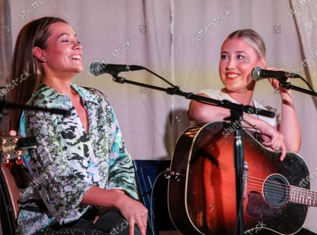 Singer/Songwriters (L-R) Taylor Dye and Madison Marlow of Maddie and Tae perform on stage at The Listening Room Cafe during The Song Suffragettes writers round.