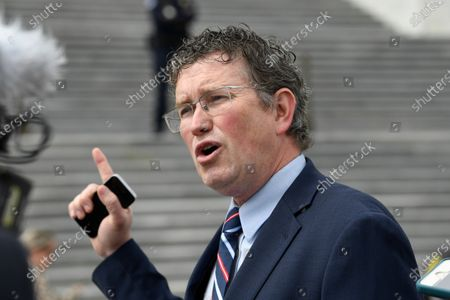 Rep. Thomas Massie, R-Ky., talks to reporters before leaving Capitol Hill in Washington. Massie says he tested positive for coronavirus antibodies and plans to donate his plasma. He made the comments recently on the radio show of political commentator Glenn Beck, the Courier-Journal reported