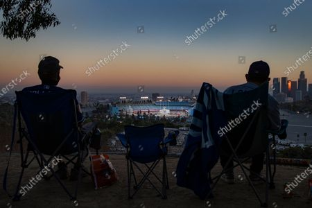 Editorial image of Fans watching Dodger game from afar at Elysian Park in Los Angeles, CA, Elysian Park, Los Angeles, California, United States - 08 Aug 2020