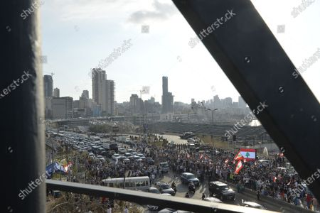 People gather near the devastated harbor area to commemorate the victims of the explosion that took place just one week earlier, in Beirut, Lebanon, 11 August 2020. The Lebanese Health Ministry said at least 160 people were killed, and more than 6,000 injured in the Beirut blast that devastated the port area on 04 August and believed to have been caused by an estimated 2,750 tons of ammonium nitrate stored in a warehouse.