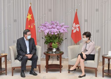 Chief Executive of China's Hong Kong Special Administrative Region (HKSAR) Carrie Lam (R) meets with the president of the HKSAR Legislative Council (LegCo) Andrew Leung, on Aug. 11, 2020. Lam relayed to Leung the decision, which was passed at the 21st session of the Standing Committee of the 13th National People's Congress on Tuesday for the sixth LegCo to continue performing duties. They also exchanged views on the resumption of operation of the LegCo.