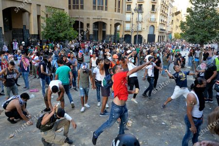Lebanese anti-government protesters throw stones at security forces during a protest near the parliament, one week after the major explosion at Beirut's harbour, Beirut, Lebanon, 11 August 2020. Lebanese Health Ministry said at least 171 people were killed, and more than 6000 injured in the Beirut blast that devastated the port area on 04 August and believed to have been caused by an estimated 2,750 tons of ammonium nitrate stored in a warehouse.