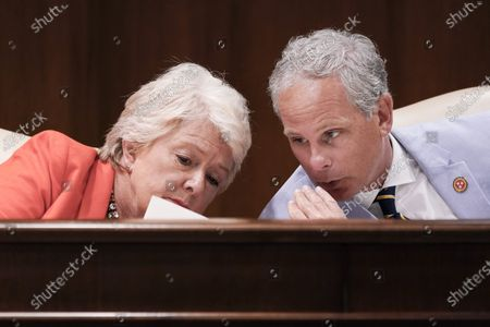 Sen. Janice Bowling, R-Tullahoma, left, talks with Sen. John Stevens, R-Huntingdon, during a meeting of the Senate Judiciary Committee, in Nashville, Tenn. The special session was called by Tennessee Gov. Bill Lee to pass liability reforms to protect businesses from lawsuits prompted by reopening after the coronavirus quarantine