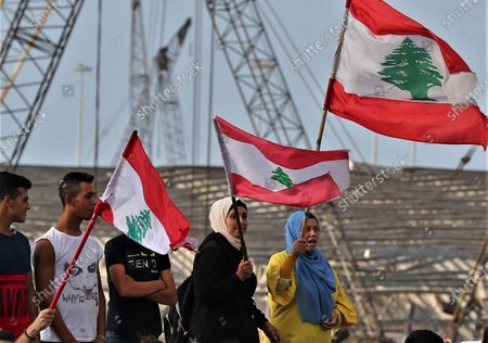 Anti-government protestors gather near the devastated harbor area to commemorate the victims of the explosion that took place just one week earlier, in Beirut, Lebanon, 11 August 2020. The Lebanese Health Ministry said at least 160 people were killed, and more than 6,000 injured in the Beirut blast that devastated the port area on 04 August and believed to have been caused by an estimated 2,750 tons of ammonium nitrate stored in a warehouse.