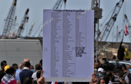 A placard with the named of the victims is held up as anti-government protestors gather near the devastated harbor area to commemorate the victims of the explosion that took place just one week earlier, in Beirut, Lebanon, 11 August 2020. The Lebanese Health Ministry said at least 160 people were killed, and more than 6,000 injured in the Beirut blast that devastated the port area on 04 August and believed to have been caused by an estimated 2,750 tons of ammonium nitrate stored in a warehouse.