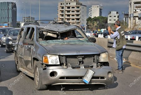 A man drive his damaged car near the devastated harbor area as anti-government protestors gather to commemorate the victims of the explosion that took place just one week earlier, in Beirut, Lebanon, 11 August 2020. The Lebanese Health Ministry said at least 160 people were killed, and more than 6,000 injured in the Beirut blast that devastated the port area on 04 August and believed to have been caused by an estimated 2,750 tons of ammonium nitrate stored in a warehouse