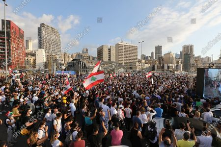 Anti-government protestors gather near the devastated harbor area to commemorate the victims of the explosion that took place just one week earlier, in Beirut, Lebanon, 11 August 2020. The Lebanese Health Ministry said at least 160 people were killed, and more than 6,000 injured in the Beirut blast that devastated the port area on 04 August and believed to have been caused by an estimated 2,750 tons of ammonium nitrate stored in a warehouse