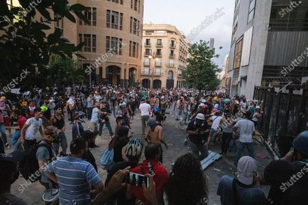 Stock Photo of Demonstrators protest against the government in Downtown Beirut, a week after an explosion killed more than 200 people so far, and caused major damage to the city.