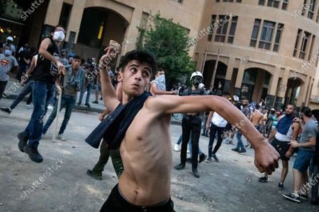 Demonstrators protest against the government in Downtown Beirut, a week after an explosion killed more than 200 people so far, and caused major damage to the city.
