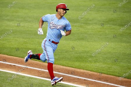 Texas Rangers' Rob Refsnyder runs to first base on a single against the Los Angeles Angels during a baseball game in Arlington, Texas, . Rangers won 7-4