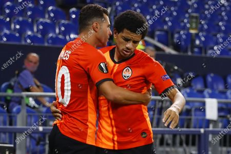 Junior Moraes of Shakhtar (L) celebrates with his team mate Taison of Shakhtar (R) after scoring the 1-0 lead during the UEFA Europa League quarter final match between Shakhtar Donetsk and FC Basel in Gelsenkirchen, Germany, 11 August 2020.