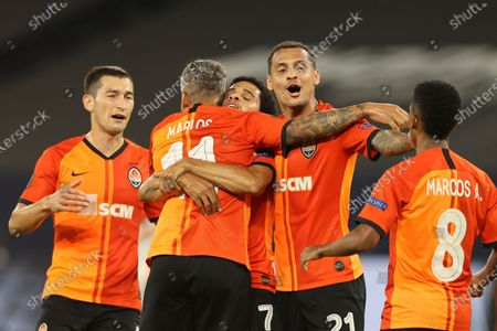 Taison of Shakhtar (C) celebrates with his team mate after scoring the 2-0 lead during the UEFA Europa League quarter final match between Shakhtar Donetsk and FC Basel in Gelsenkirchen, Germany, 11 August 2020.