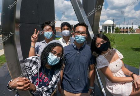 Stock Image of Rising seniors at the Thomas Jefferson High School for Science and Technology gather on the campus in Alexandria, Va., . From left in front are, Dinan Elsyad, 17, Sean Nguyen, 16, and Tiffany Ji, 17. From left at rear are, Jordan Lee, 17, and Shibli Nomani, 17